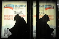 A man (and his reflection) at a bus stop in Moscow in 2011. A drunken man racing at 200 kilometres (125 miles) per hour through Moscow slammed into a bus stop queue Saturday, instantly killing four children and three adults, a police spokesman said. News reports said police had detained the suspect. The children's ages ranged between 14 and 16