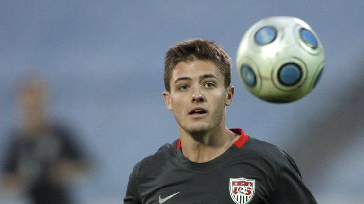 "FILE - In this Nov. 14, 2009, file photo, Robbie Rogers, of the United States, eyes the ball during the friendly soccer match against Slovakia in Bratislava, Slovakia. Former MLS and U.S. national team player Robbie Rogers says he is gay. In a post on his personal website, Rogers writes: ""Life is only complete when your loved ones know you. ... Try explaining to your loved ones after 25 years you are gay.""(AP Photo/Petr David Josek, File)"