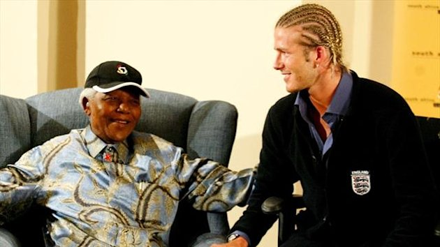 Former South African President Nelson Mandela chats with David Beckham (Reuters)