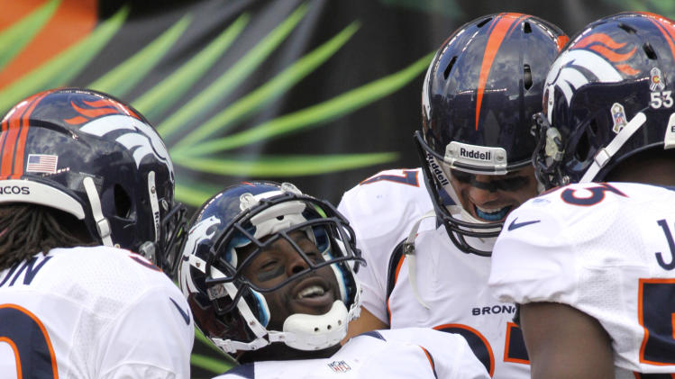 Denver Broncos wide receiver Trindon Holliday (11) celebrates after scoring on a 105-yard kickoff return in the second half of an NFL football game against the Denver Broncos, Sunday, Nov. 4, 2012, in Cincinnati. (AP Photo/Tom Uhlman)