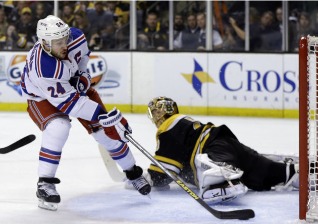New York Rangers right wing Ryan Callahan, left, scores against Boston Bruins goalie Tuukka Rask, right, during the first period in Game 2 of the NHL Eastern Conference semifinal hockey playoff series