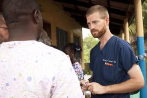 Handout photo of Dr. Kent Brantly speaking with colleagues at the case management center on the campus of ELWA Hospital in Monrovia