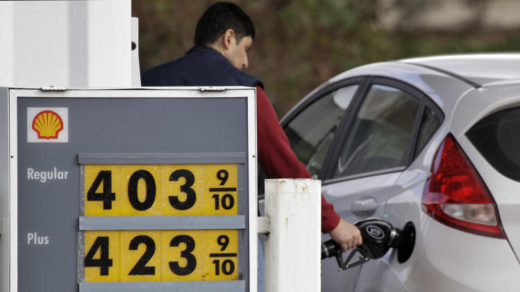 Prices for three grades of gasoline are posted in front of a service station Wednesday, Feb. 22, 2012, in Bellevue, Wash., near Seattle. A four-day rise in oil prices stalled Wednesday following a weak report on Chinese manufacturing and lingering concerns about Greece's bailout. The price of West Texas Intermediate, the benchmark for oils produced in the U.S., fell 46 cents to $105.79 a barrel in afternoon trading on the New York Mercantile Exchange. (AP Photo/Elaine Thompson)