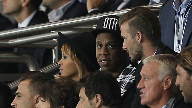 Former England and PSG soccer player David Beckham, top right, Beyonce, top left, and her husband Jay Z watch the Champions League soccer match between PSG and Barcelona, at the Parc des Princes stadium, in Paris, Tuesday, Sept. 30, 2014