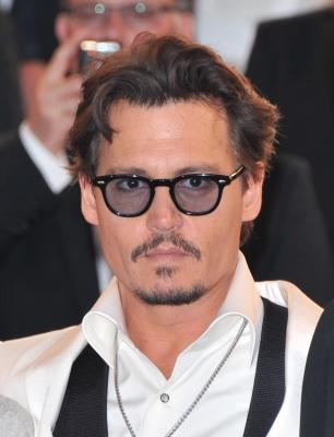 "Johnny Depp departs the ""Pirates of the Caribbean: On Stranger Tides"" premiere during the 64th Annual Cannes Film Festival at Palais des Festivals on May 14, 2011 in Cannes, France -- FilmMagic"