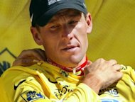 Lance Armstrong puts on the yellow jersey as overall leader on the podium at the end of the 14th stage of the Tour de France cycling race in July 2003. The 1999-2005 Tour de France races will have no winners attributed to them, embattled world cycling officials announced Friday
