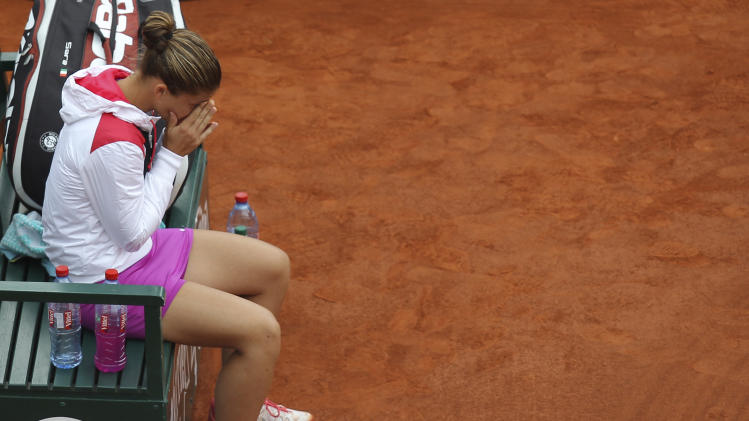 Italy's Sara Errani sits on her bench after losing to Russia's Maria Sharapova during their women's final match in the French Open tennis tournament at the Roland Garros stadium in Paris, Saturday, June 9, 2012. Sharapova won 6-3, 6-2. (AP Photo/David Vincent)