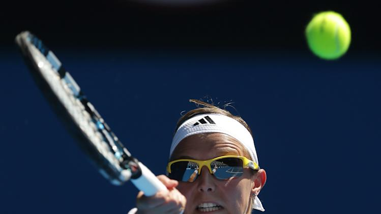 Belgium's Kirsten Flipkens makes a forehand return to Russia's Maria Sharapova during their fourth round match at the Australian Open tennis championship in Melbourne, Australia, Sunday, Jan. 20, 2013. (AP Photo/Dita Alangkara)