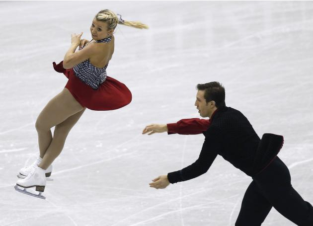 Moore-Towers and Moscovitch of Canada perform during the pairs short programme at the ISU Grand Prix of Figure Skating Final in Fukuoka