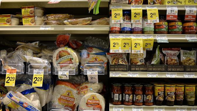 "Tortillas and other items are seen in the International food aisle of a grocery store Wednesday, Oct. 16, 2013 in Washington. These days, tortillas outsell burger and hot dog buns; sales of tortilla chips trump potato chips; and tacos and burritos have become so ubiquitously ""American,"" most people don't even consider them ethnic. (AP Photo/Alex Brandon)"