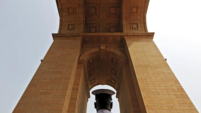 An Indian Naval soldier pays respect at the India Gate war memorial during a ceremony to commemorate 50th anniversary of a war between India and Pakistan, in New Delhi