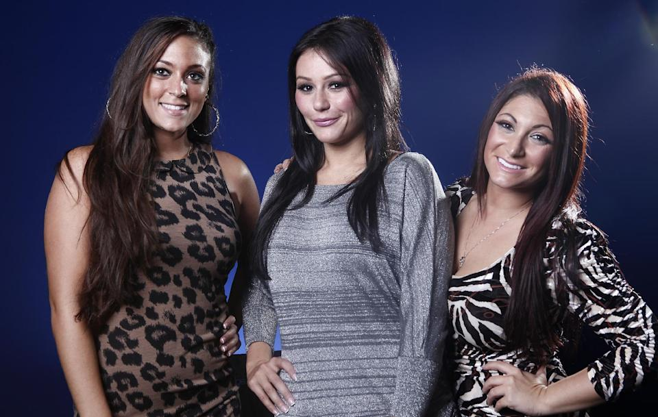"This Oct. 3, 2012 photo shows cast members from ""Jersey Shore,"" from left, Sammi ""Sweetheart"" Giancola, Jenni ""JWOW"" Farley, and Deena Cortese pose for a portrait in New York. The final season of the MTV reality season premieres on Thursday. (Photo by Carlo Allegri/Invision/AP)"