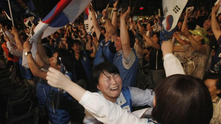 South Koreans celebrate after Pyeongchang won the right to host the 2018 Winter Olympics in Chuncheon, South Korea, Thursday, July 7, 2011. The South Korean city of Pyeongchang was awarded the 2018 Winter Olympics on Wednesday, taking the games to a new territory in Asia after failing in two previous attempts. (AP Photo/AhnnYoung-joon)