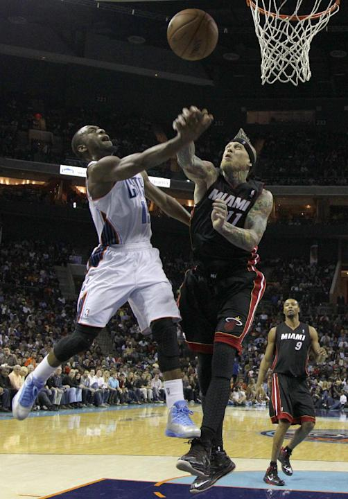 Charlotte Bobcats' Kemba Walker, left, is fouled by Miami Heat's Chris Andersen during the second half of an NBA basketball game in Charlotte, N.C., Saturday, Nov. 16, 2013. Miami won 97-81
