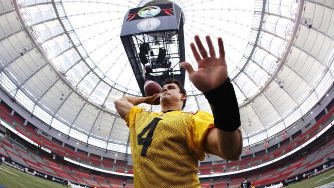 Hamilton Tiger-Cats quarterback Zach Collaros throws a pass during their team's practice at the CFL's 102nd Grey Cup week in Vancouver