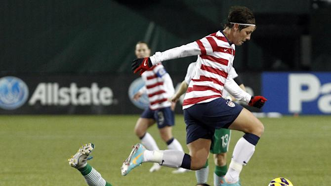 United States forward Abby Wambach, right, leaps over Ireland defender Sophie Perry during the first half of their exhibition soccer match in Portland, Ore., Wednesday, Nov. 28, 2012.( AP Photo/Don Ryan)