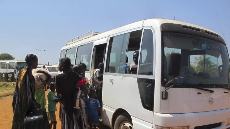 Displaced Sudanese families prepare to board a bus at the UNMISS compound, on the outskirts of the capital Juba