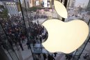 FILE - In this Oct. 20, 2012 photo, people line up to enter a newly-opened Apple Store in Wangfujing shopping district in Beijing. Apple's profit surge halted in the latest quarter, as a flood of new products like the iPhone 5 meant high start-up costs for new production lines. Apple posted net income for the October to December quarter that was flat with the year before. It was the first time in years that Apple didn't post a double-digit earnings increase. (AP Photo/Andy Wong, File)