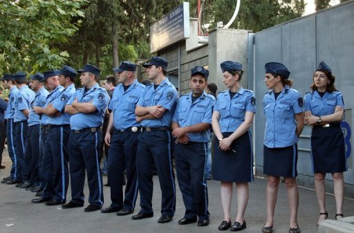 <p>Georgian police officers block the entrance of a warehouse which stored satellite antennas owned by cable operator Global TV in Tbilisi. Georgia's opposition accused the government Friday of trying to keep it off the airwaves after police impounded 300,000 satellite dishes intended to boost an opposition tycoon's TV station.</p>