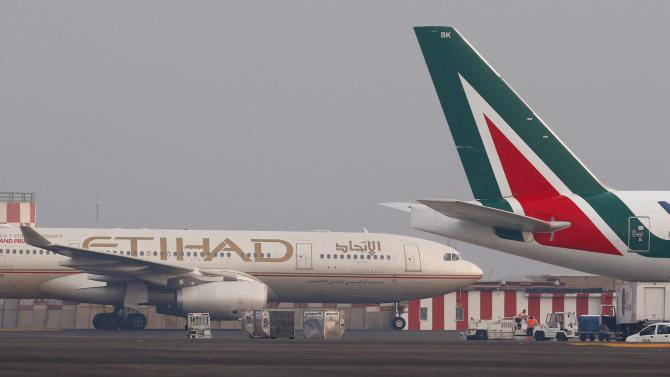Alitalia and Etihad planes are pictured before take-off at Fiumicino airport in Rome