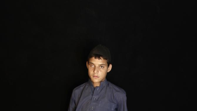 HOLD FOR A STROY SLUGGED PAKISTAN TALIBAN'S VICTIMS BY ASIF SHAHZAD, In this Thursday, July 12, 2012, photo, Pakistani student Yaseen Azizul Rahman, 19, who was injured in 2007 by a remote control bomb in Peshawar, poses for a picture, in Peshawar, Pakistan. To many victims of Taliban violence, the idea of negotiating with people responsible for so much human pain is abhorrent. Their voices, however, are rarely heard in Pakistan, a country where people have long been conflicted about whether the Taliban are enemies bent on destroying the state or fellow Muslims who should be welcomed back into the fold after years of fighting.(AP Photo/Muhammed Muheisen)