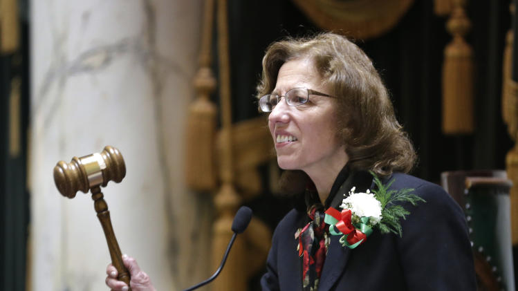 In this Tuesday, March 19, 2013 photo Rhode Island Senate President Teresa Paiva Weed lowers the gavel at the rostrum in the Senate Chamber at the Statehouse, in Providence, R.I. Paiva Weed said she intends to vote against gay marriage legislation in the Rhode Island Senate Wednesday. (AP Photo/Steven Senne)