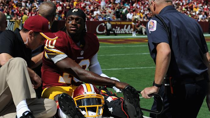 Quarterback Robert Griffin III of the Washington Redskins is carted off the field after being injured during their game against the Jacksonville Jaguars, at FedExField in Landover, Maryland, on September 14, 2014