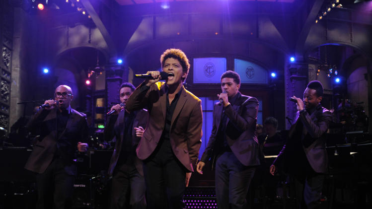 "This Oct. 20, 2012 photo released by NBC shows guest host Bruno Mars performing on ""Saturday Night Live,"" in New York.  Mars' recent appearance on ""Saturday Night Live"" was more like Saturday Night Fever: He says he had so much fun hosting the show that he'd be happy to do it again. ""Whatever 'SNL' wants from me, they can always call me,"" the smiling 27-year-old said in an interview Wednesday afternoon. ""I don't know who told them I can act or anything 'cause I can't. I don't know what they saw. (But) whatever they need from me, they can get."" (AP Photo/NBC, Dana Edelson)"