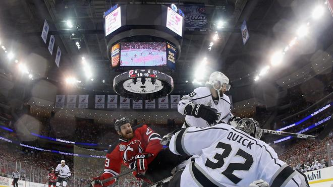 David Clarkson #23 Of The New Jersey Devils Loses His Balance In Front Of Jonathan Quick #32 And Drew Doughty #8 Of  Getty Images