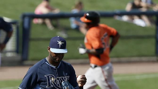 Tampa Bay Rays starting pitcher Robert Zarate walks back onto the mound as Baltimore Orioles' Michael Almanzar rounds third following his solo home run off of Zarate in the ninth inning of a spring training baseball game in Port Charlotte, Fla., Thursday March 5, 2015. The Orioles won 3-2.  (AP Photo/Tony Gutierrez)
