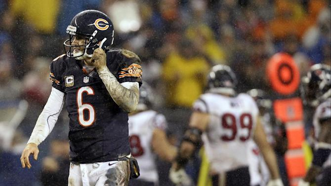 Chicago Bears quarterback Jay Cutler (6) walks off the field after a play against the Houston Texans in the first half an NFL football game in Chicago, Sunday, Nov. 11, 2012. (AP Photo/Nam Y. Huh)