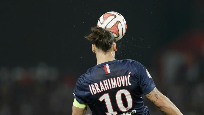 Paris St Germain's Ibrahimovic heads the ball against Olymique Lyon during their French Ligue 1 soccer match at the Parc des Princes Stadium in Paris
