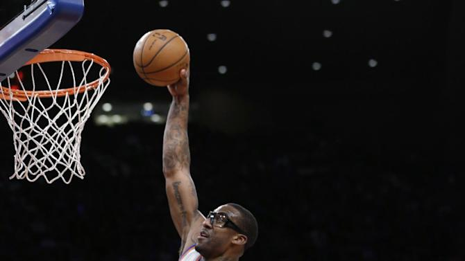 New York Knicks forward Amare Stoudemire (1) dunks during the first half an NBA basketball game against the Detroit Pistons at Madison Square Garden in New York, Monday, Feb. 4, 2013. (AP Photo/Kathy Willens)