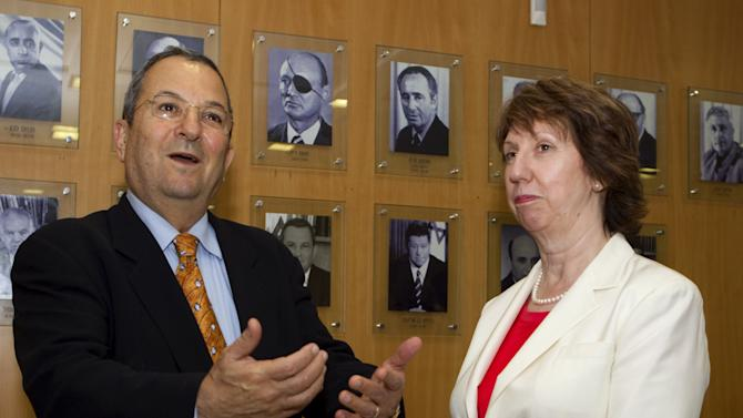 EU Foreign Policy Chief Catherine Ashton, right, listens as Israeli Defense Minister Ehud Barak speaks to journalists before their meeting in Tel Aviv, Sunday, Aug. 28, 2011. Ashton is on an official visit to Israel and the Palestinian territories. (AP Photo/Jack Guez, Pool)