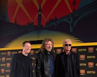 "British rock band Led Zeppelin's (L-R) John Paul Jones, Robert Plant and Jimmy Page pose at a press conference to announce the release of a video recording of their one-off 2007 concert in London. Plant conceded he does not understand the lyrics of the band's best-known song, ""Stairway to Heaven"", as the band dodged questions about a possible reunion"
