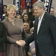 Premier Kathy Dunderdale shakes Prime Minister Stephen Harper&#39;s hand after a campaign rally on March 31, 2011.