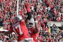 Ohio State running back Jalin Marshall, left, celebrates his touchdown against Indiana with teammate Armani Reeves during the third quarter of an NCAA college football game Saturday, Nov. 22, 2014, in Columbus, Ohio. Ohio State won 42-27. (AP Photo/Jay LaPrete)