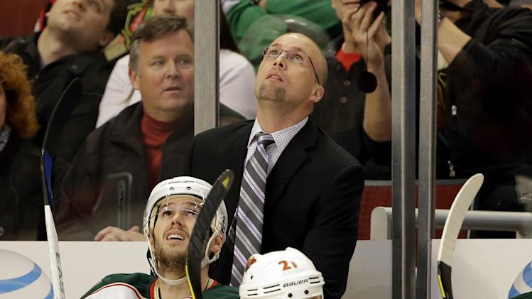 Minnesota Wild head coach Mike Yeo looks up at the scoreboard during the first period of Game 2 of an NHL hockey Stanley Cup first-round playoff series against the Chicago Blackhawks in Chicago, Friday, May 3, 2013. (AP Photo/Nam Y. Huh)