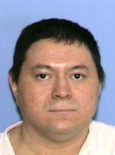 This handout photo provided by the Texas Department of Public Safety shows Michael Blair. When Blair was sent to death row for the infamous murder of 7-year-old Ashley Estell, he insisted he never killed anyone. More than a decade later, genetic testing showed he was telling the truth. But during those long years behind bars, Blair confessed to raping two other children, a crime for which he's serving multiple life sentences. Blair has made an unlikely demand, asking the state for nearly $1 million as compensation for being wrongfully convicted. His request has gone all the way to the Texas Supreme Court and is forcing a re-examination of laws designed to offer exonerated inmates a new start.  (AP Photo/ Texas Department of Public Safety)