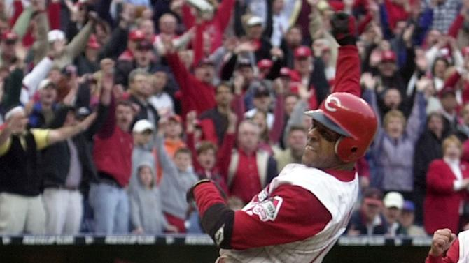 FILE - In this April 1, 2002 file photo, Cincinnati Reds' Barry Larkin celebrates after scoring the winning run against the Chicago Cubs in the bottom of the ninth inning,  in Cincinnati. Cubs catcher Robert Machado is at right.  Larkin has been elected to baseball's Hall of Fame. The shortstop received 86 percent of the vote in balloting announced Monday, Jan. 9, 2012 by the Baseball Writers' Association of America.(AP Photo/David Kohl, FIle)