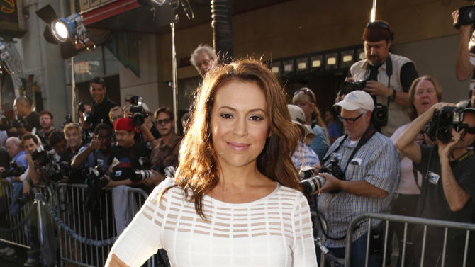 """Alyssa Milano arrives at the LA premiere of """"42"""" at the TCL Chinese Theater on Tuesday, April 9, 2013 in Los Angeles. (Photo by Todd Williamson /Invision/AP)"""