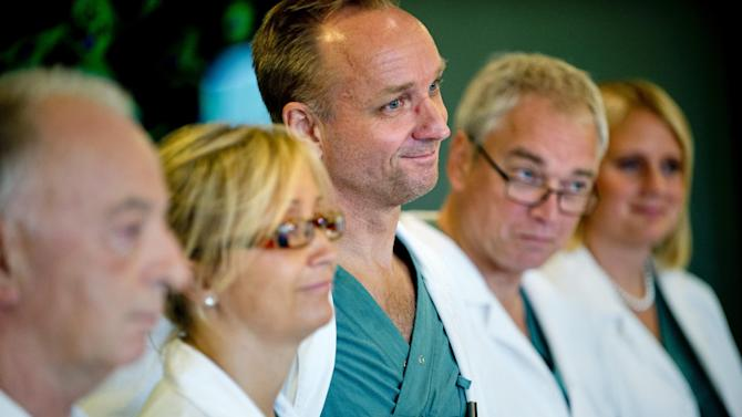 From left specialist surgeons Andreas G Tzakis, Pernilla Dahm-Kähler, Mats Brannstrom, Michael Olausson and Liza Johannesson attend a news conference Tuesday Sept. 18, 2012 at Sahlgrenska hospital in Goteborg Sweden. Two Swedish women are carrying the wombs of their mothers after what doctors called the world's first mother-to-daughter uterus transplants.  The specialists at the University of Goteborg completed the surgery over the weekend without complications, but say they won't consider the procedures successful unless the women achieve pregnancy after their observation period ends a year from now.  (AP Photo/Adam Ihse) SWEDEN OUT