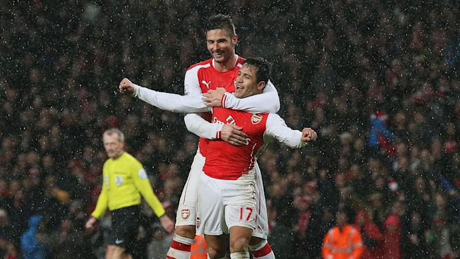 Arsenal's Alexis Sanchez, right, celebrates scoring a goal with teammate Oliver Giroud during the English Premier League soccer match between Arsenal and Queens Park Rangers at the Emirates Stadium, London, Friday, Dec. 26, 2014. (AP Photo/Tim Ireland)