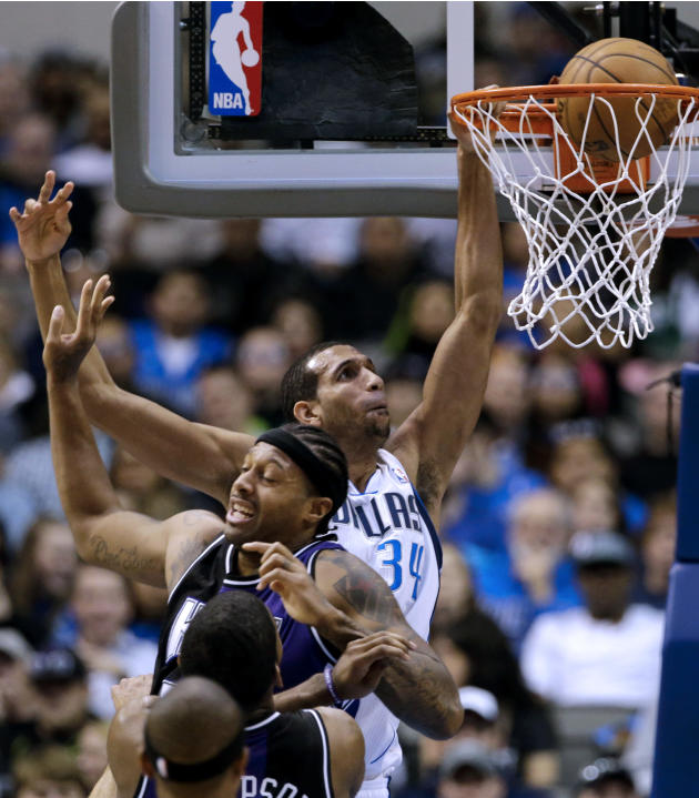 Dallas Mavericks' Brandan Wright, rear, goes up for a dunk attempt that rimmed out over Sacramento Kings' James Johnson, center front, in the first half of an NBA basketball game Wednesday, Feb. 13, 2