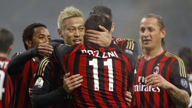 AC Milan's Giampaolo Pazzini (11) celebrates with his teammate Keisuke Honda after scoring the second goal against Spezia during their Italian Cup match (Reuters)