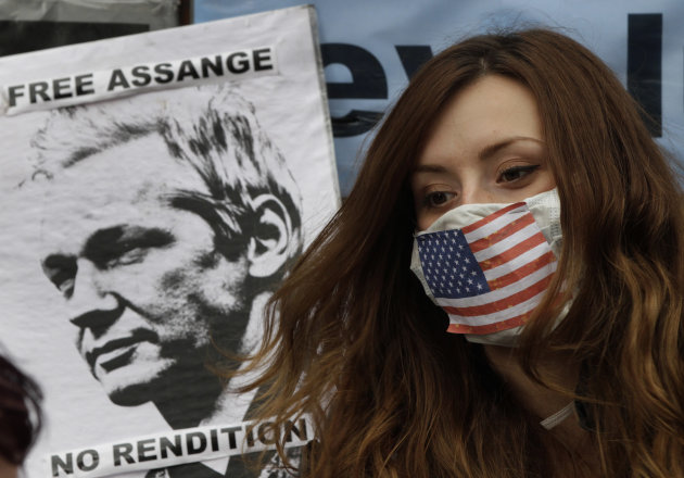 A supporter of WikiLeaks founder Julian Assange sits outside the Ecuadorian Embassy, in London, Friday, June 22, 2012. Assange entered the embassy on Monday in an attempt to gain political asylum to prevent him from being extradited to Sweden to face allegations of sex crimes, which he denies. In a telephone interview with the Australian Broadcasting Corporation (ABC) from inside the embassy, the 40-year-old Australian said he did not know when the decision would be made. (AP Photo/Lefteris Pitarakis)