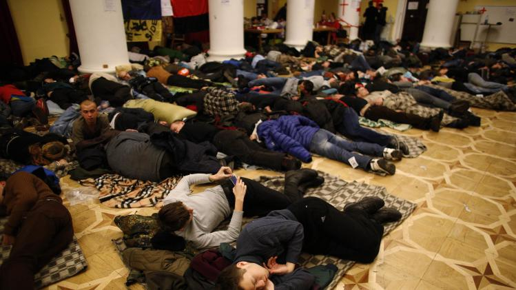 Protesters rest in Kiev's City Hall, now an organisational hub for protesters who have occupied the building