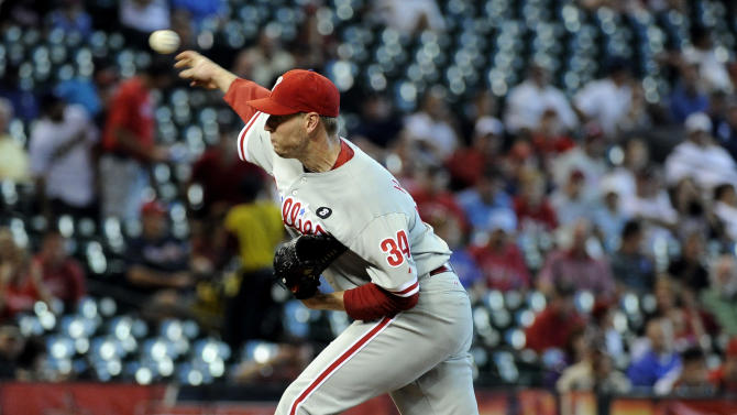 Philadelphia Phillies' Roy Halladay delivers a pitch in the first inning of a baseball game against the Houston Astros Wednesday, Sept. 14, 2011, in Houston. (AP Photo/Pat Sullivan)