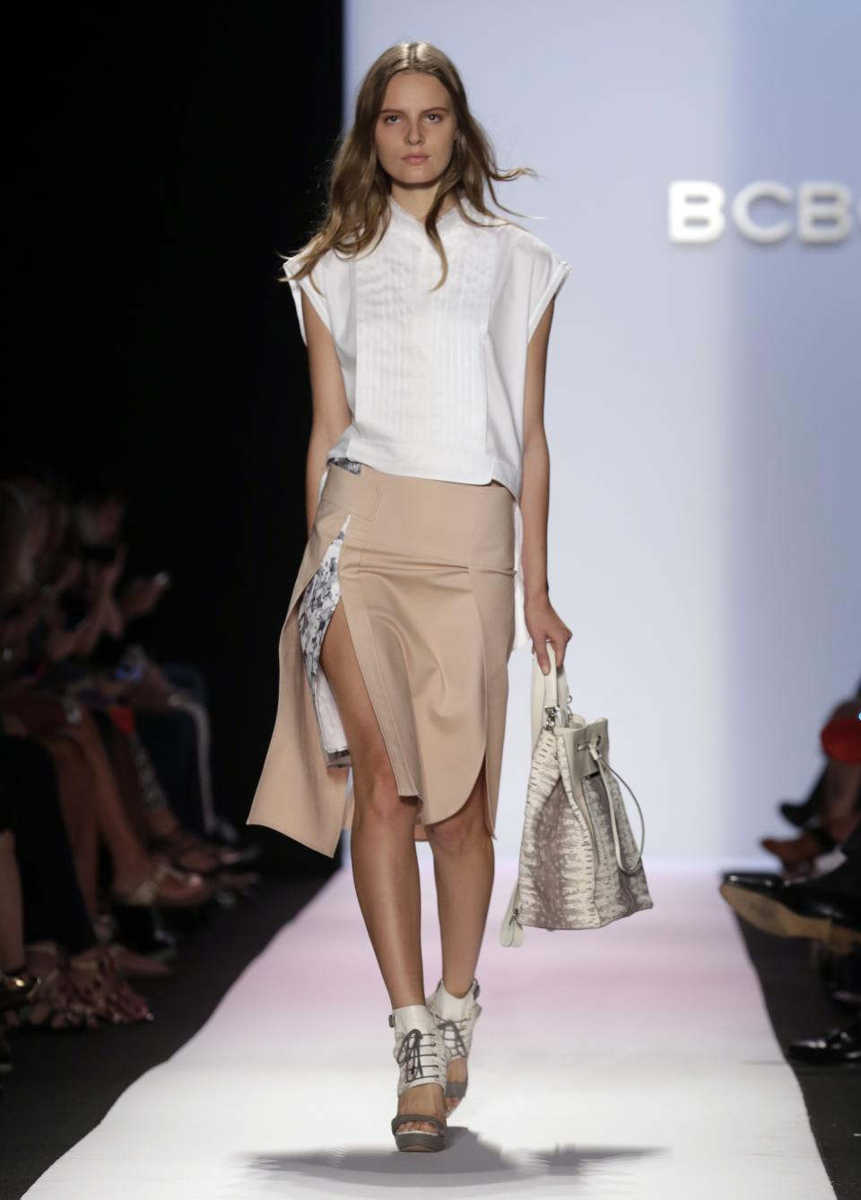 The BCBG MAX AZRIA Spring 2014 collection is modeled during Fashion Week in New York, Thursday, Sept. 5, 2013. (AP Photo/Richard Drew)