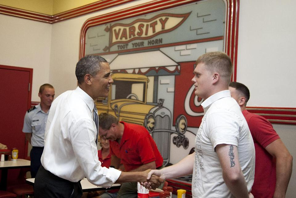 President Barack Obama shakes hands with patrons during his visit to The Varsity restaurant, Tuesday, June 26, 2012, in Atlanta. (AP Photo/Carolyn Kaster)